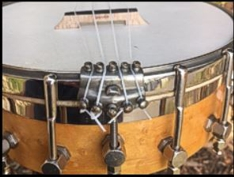 Ditson ukulele-banjo - end view